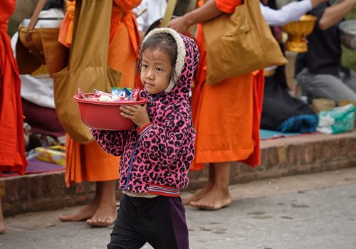 Isabelle Redemption the secret of happiness Child beggar bowl sweets alms Luang Prabang Laos
